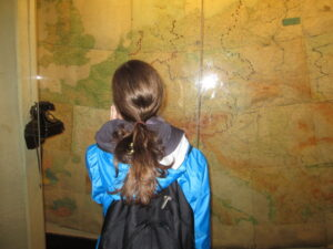 DHA Elizabeth admires a large wall map